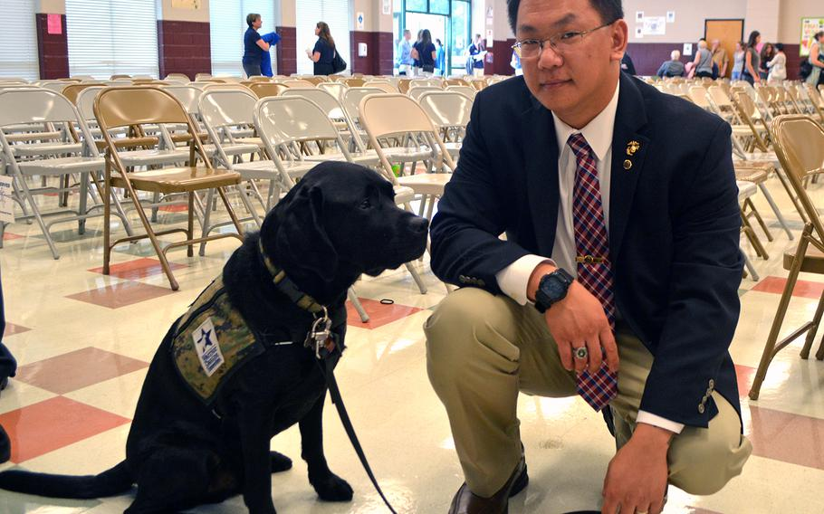 Retired Marine Sgt. Michael Boudreau poses with his sevice dog Tamer - named after Ret. Gen. John Amos - after the Warrior Canine Connection graduation on Oct. 7, 2017.
