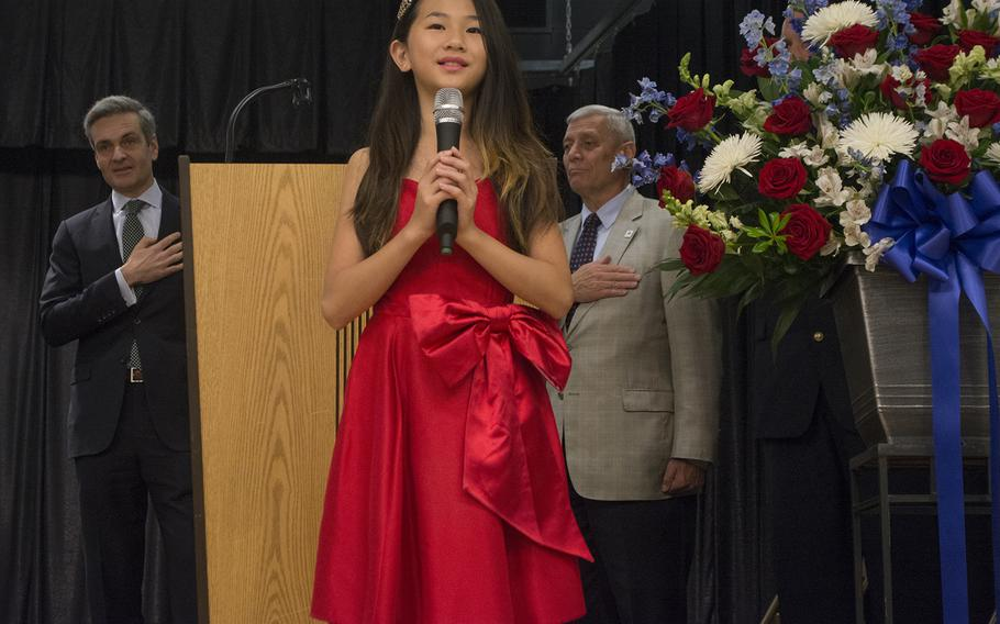 Rachel Wu sings the National Anthem at the start of the Warrior Canine Connection's graduation ceremony on Oct. 7, 2017.