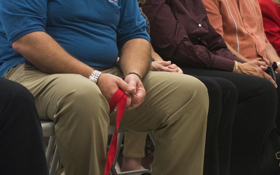 Al Bucca watches opening remarks of the Warrior Canine Connection graduation ceremony on Oct. 7, 2017. At his feet is service dog Bucca, named after his brother Ron Bucca, who died in the Sept. 11, 2001 attacks in NYC.