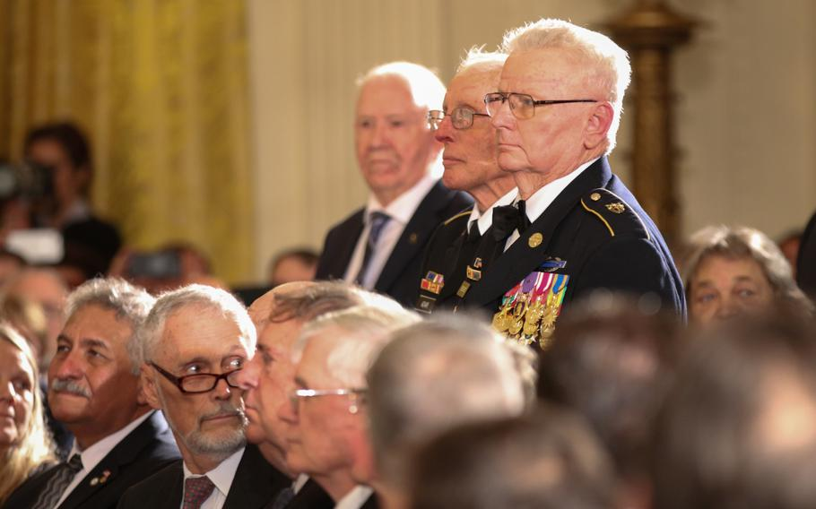 Soldiers who served with retired Army Capt. Gary M. Rose stand during Rose's Medal of Honor ceremony held at the White House on Oct. 23, 2017.