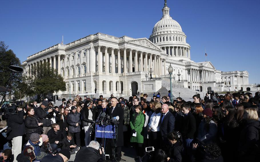 Rep. Ted Deutch, D-Fla., speaks at the podium where he is joined by students and parents from Marjory Stoneman Douglas High School, in Parkland., Fla., Friday, March 23, 2018, during a news conference about gun violence on Capitol Hill in Washington, ahead of the Saturday March For Our Lives.
