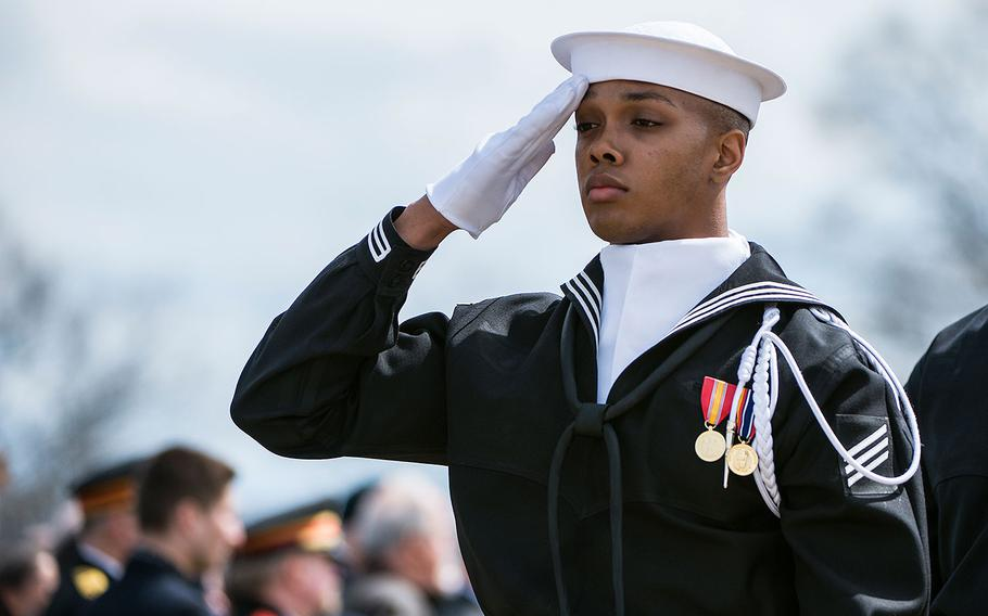 A sailor from the U.S. Navy Ceremonial Guard renders honors during the full honors funeral for Capt. Thomas J. Hudner in Section 54 of Arlington National Cemetery, Virginia on April 4, 2018.