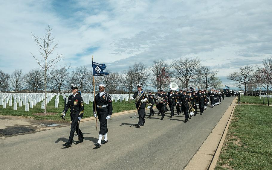 The U.S. Navy Ceremonial Guard, The U.S. Navy Band, and The 3d U.S. Infantry Regiment (The Old Guard) Caisson Platoon participate in the full honors funeral of U.S. Navy Capt. Thomas J. Hudner in Section 54 of Arlington National Cemetery on April 4, 2018.