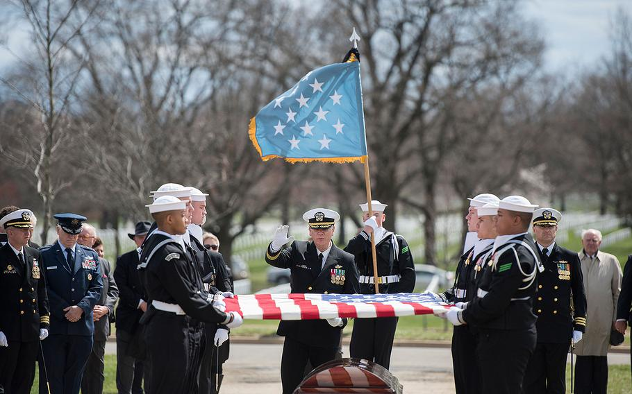 A U.S. Navy chaplain delivers remarks during the funeral for Capt. Thomas J. Hudner at Arlington National Cemetery in Virginia on Wednesday, April 4, 2018.