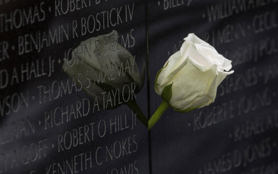 A rose placed by his brother and sister, Cindy Hill Kelly and Bruce Hill, marks the name of Army Chief Warrant Officer Robert O. Hill Jr. at the Vietnam Veterans Memorial in Washington, D.C., on Memorial Day, May 28, 2018. Hill died on Sept. 27, 1970 in Quang Tri province.