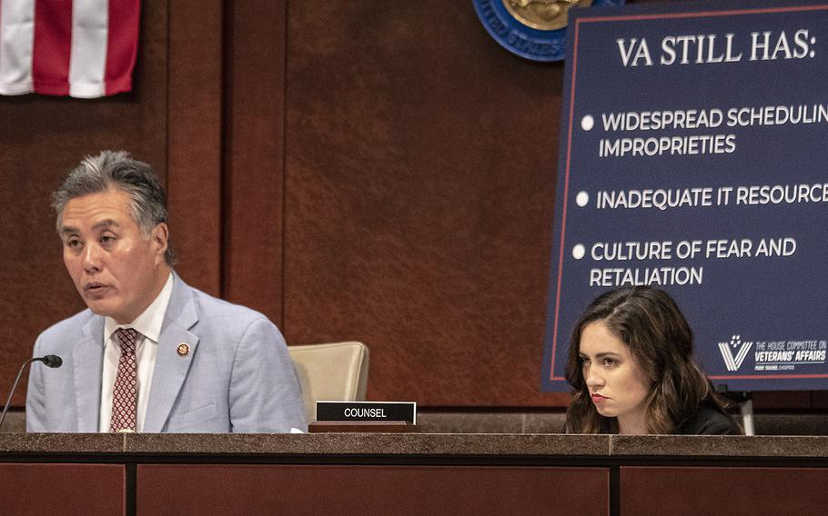House Veterans' Affairs Committee Chairman Rep. Mark Takano, D-Calif., makes his opening statement during a hearing on the situation with wait times at VA hospitals, five years after the Phoenix scandal, July 24, 2019 on Capitol Hill. Behind him is a poster listing the problems he says the VA still encounters.