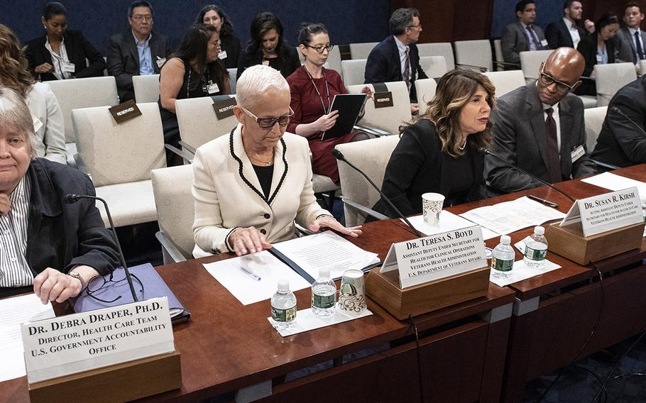 Awaiting the start of a House Veterans' Affairs Committee hearing on the situation with wait times at VA hospitals, five years after the Phoenix scandal, July 24, 2019 on Capitol Hill are, left to right, Dr. Debra A. Draper, director of the Government Accountability Office's health care team; Dr. Teresa S. Boyd, Veterans Health Administration assistant deputy under secretary for health for clinical operations' Dr. Susan R. Kirsh, Veterans Health Administration acting assistant deputy under secretary for health for access to care; Dr. Clinton (Leo) Greenstone, deputy executive director for clinical integrity of the Veterans Health Administration's Office of Community Care; and Dr. Kenneth W. Kizer, chief healthcare transformation officer and senior executive vice president of Atlas Research, Inc.