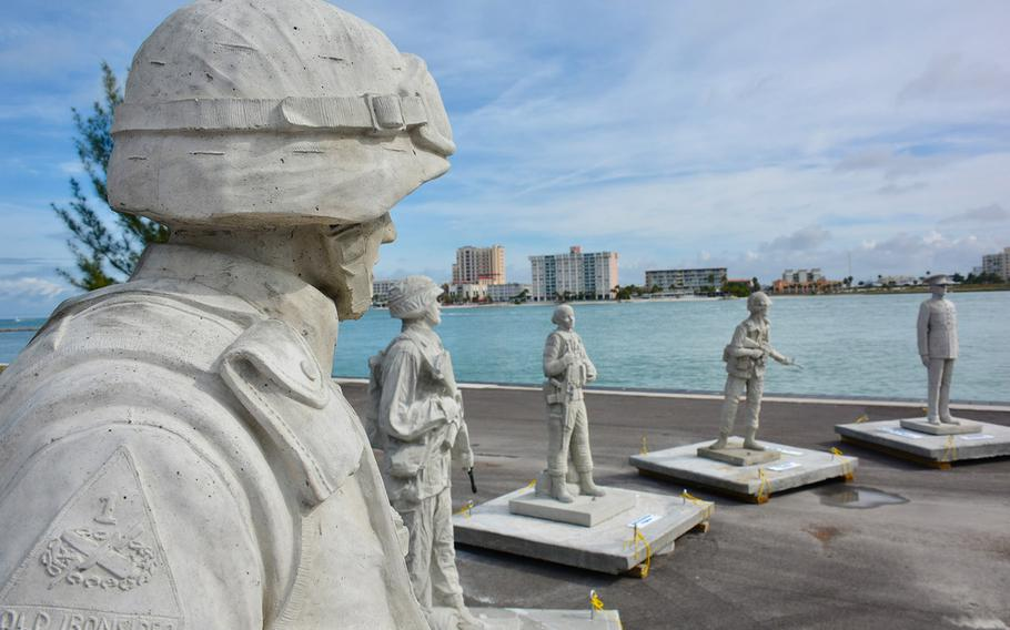 Some of the Circle of Heroes Veterans Memorial statues, before they were lowered into the Gulf of Mexico.
