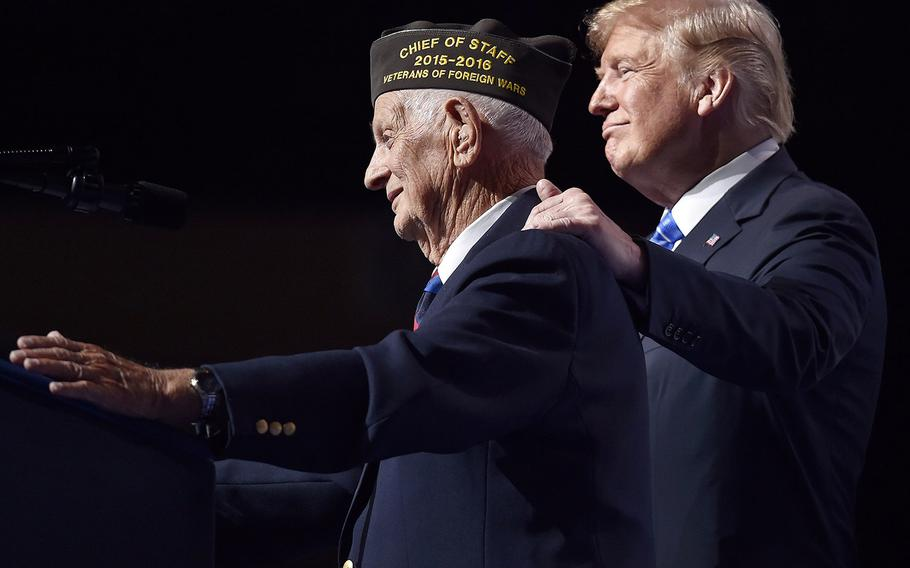 President Donald Trump honors World War II veteran Allen Q. Jones on Tuesday, July 24, 2018, by inviting the 94-year-old onto the stage at the VFW convention in the Kansas City, Mo., Municipal Auditorium.