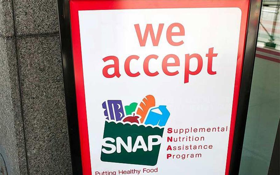 A sign indicates a store that accepts the Supplemental Nutritional Assistance Program or SNAP, the official name of the food stamp program.