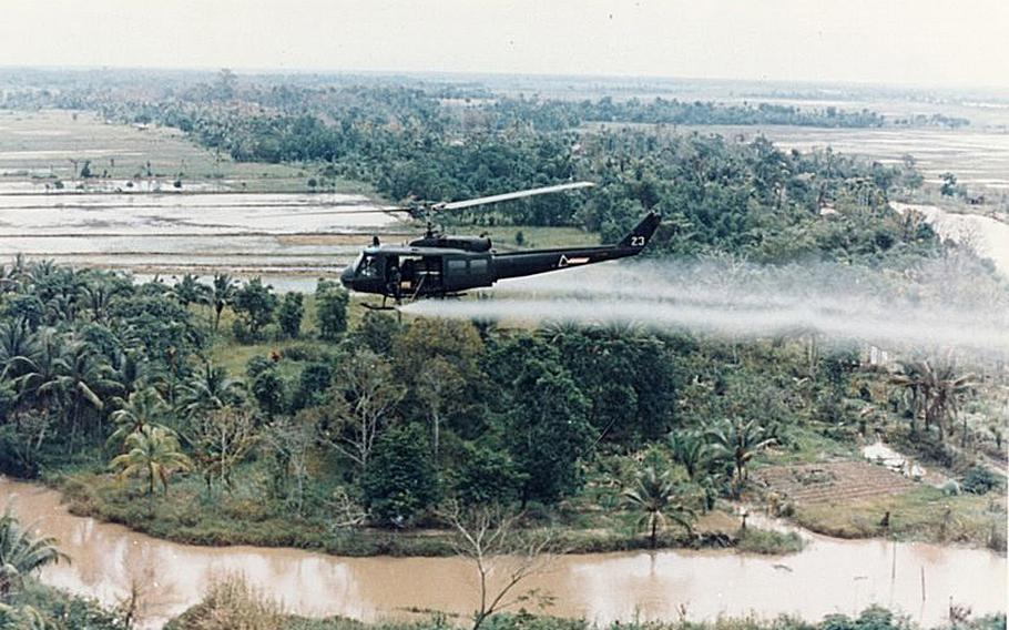 """A U.S. Huey helicopter sprays Agent Orange over Vietnam. Those who served """"in-country"""" in Vietnam enjoy a nearly automatic VA presumption that they were exposed to these herbicides, sometimes popularly called """"Agent Orange."""" Those who served in Thailand are offered no such presumption."""