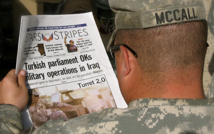 U.S. Army Sgt. Roger McCall, 153rd Military Police Company, reads an edition of Stars and Stripes while in the Green Zone, Baghdad, Oct. 18, 2007.