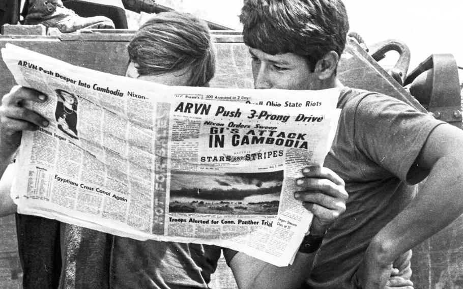 In a May, 1970 photo, soldiers taking part in Operation Fishhook in Cambodia read Stars and Stripes' coverage of the events.