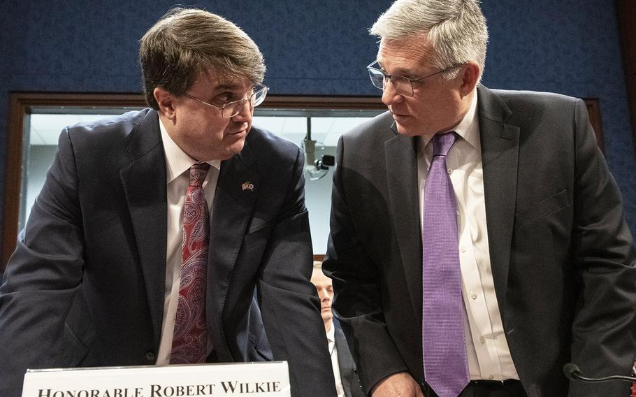 Secretary of Veterans Affairs Robert Wilkie, left, talks with Veterans Health Administration Executive in Charge Dr. Richard Stone before a House Veterans' Affairs Committee hearing on Capitol Hill, Feb. 27, 2020.
