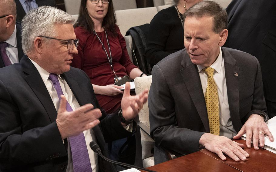 Veterans Health Administration Executive in Charge Dr. Richard Stone, left, talks with VA Under Secretary for Benefits Dr. Paul Lawrence before a House Veterans' Affairs Committee hearing on Capitol Hill, Feb. 27, 2020.