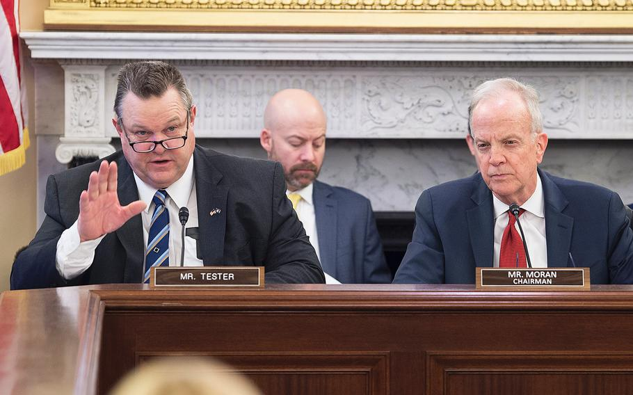 Senate Veterans Affairs Committee Ranking Member Sen. Jon Tester, D-Mont., asks questions to witnesses during a hearing on Capitol Hill in Washington on Wednesday, Feb. 5, 2020. Looking on at right is committee Chairman Jerry Moran, R-Kansas.