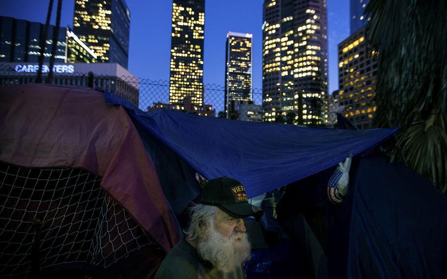 In a 2017 photo, a Vietnam War veteran is shown in his tent on South Beaudry Avenue in Los Angeles.