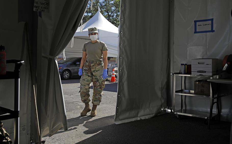 A member of the Nevada Army National Guard works at a drive-thru coronavirus testing site Tuesday, April 28, 2020, in Las Vegas.