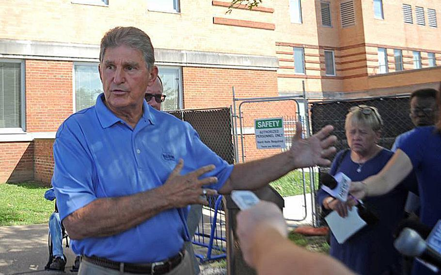 Sen. Joe Manchin answers questions outside of the Louis A. Johnson VA Medical Center in Clarksburg, W.Va. Manchin had called for an expedited investigation into the suspicious deaths at the hospital. Court documents unsealed Tuesday, July 14, 2020, show Reta Mays, a former nursing assistant at the  facility is being charged with second degree murder in the deaths of seven people.