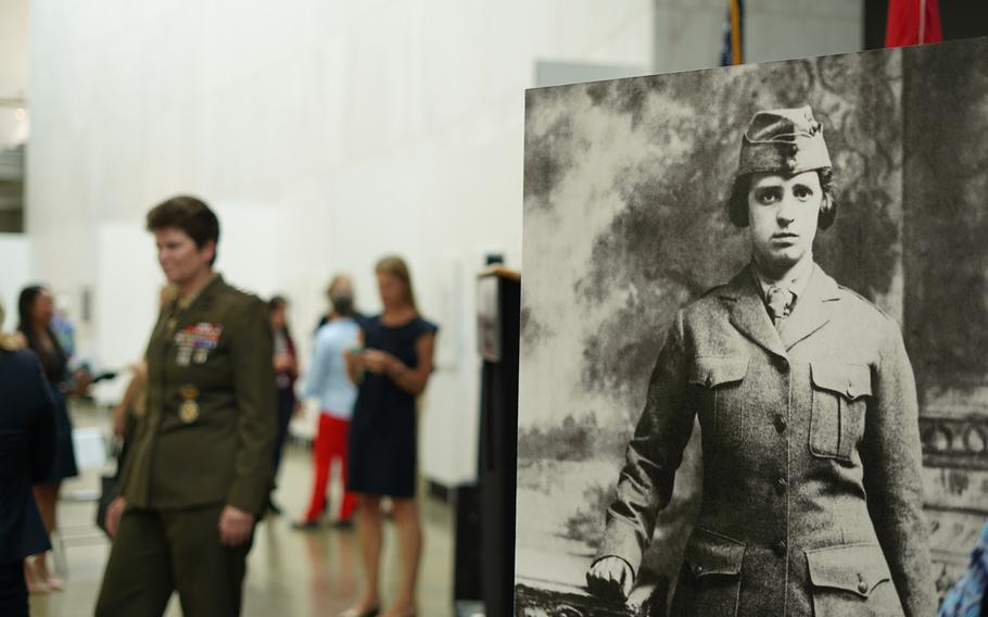 A portrait a female Marine is displayed at the exhibition Women Marines — Proudly Serving 1918-2018 at the Women in Military Service for America Memorial in Arlington, Va., on Aug. 12, 2018.
