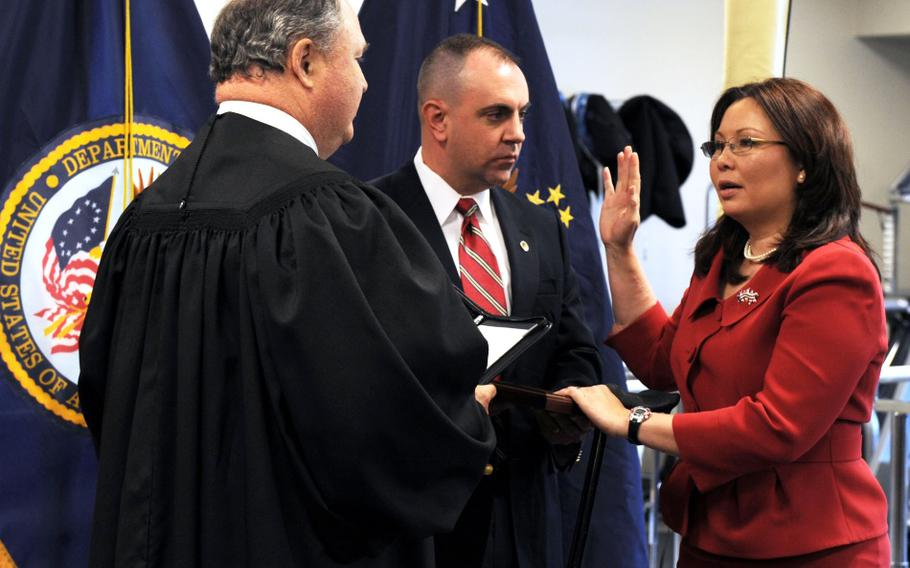 In a May, 2009 photo, Tammy Duckworth, then-assistant secretary of veterans affairs for public and intergovernmental affairs, is sworn into federal office by Judge John J. Farley, left, U.S. Court of Appeals for Veterans Claims. Duckworth's husband, Army National Guard Maj. Bryan Bowlsbey, presided over the oath. Duckworth is one of the people who is being mentioned as a possible VA secretary in the Biden administration.