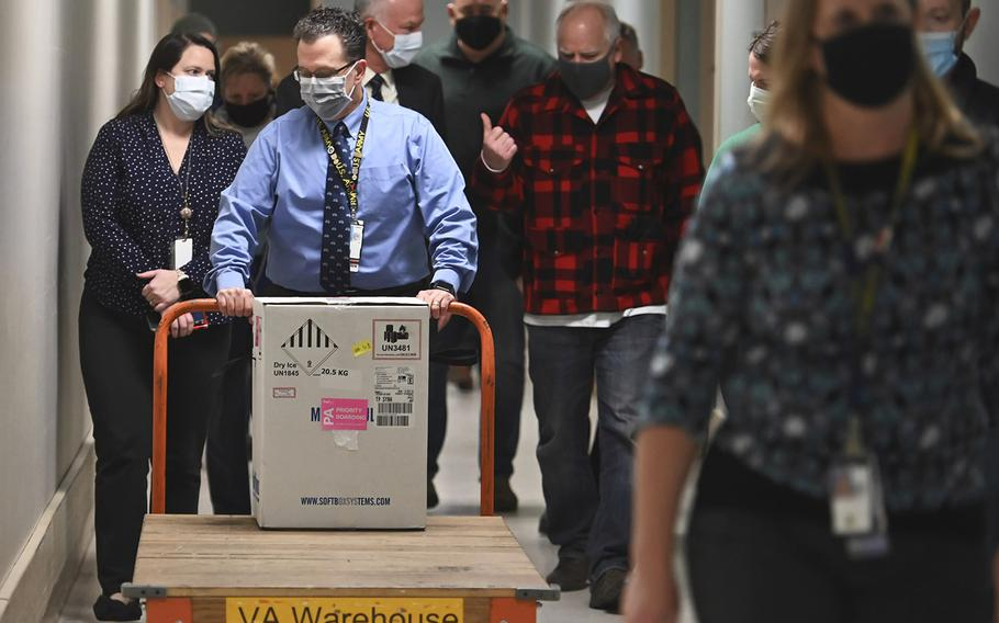 Minnesota Gov. Tim Walz follows the first delivery of the Pfizer-BioNTech COVID-19 vaccines into the Minneapolis VA Hospital, Monday, Dec. 14, 2020.