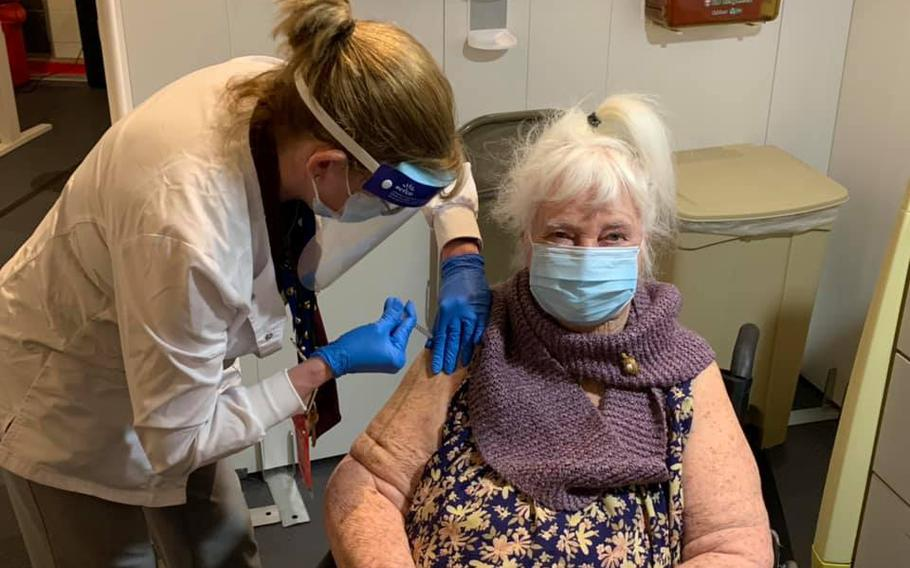 World War II Veteran Margaret Klessens, 96, a resident at the Community Living Center in the Edith Nourse Rogers Memorial Veterans Hospital at VA Bedford, Mass., is the first VA patient nationwide to receive the COVID-19 vaccine, Dec. 14, 2020.