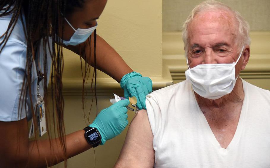 Korean War veteran Norman Hale, 90 of Vinemont gets his coronavirus vaccine shot from RN Precious Reynolds at the Birmingham VA Medical Center, December 17, 2020.