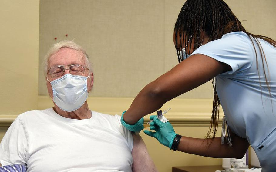 World War II veteran Lee Elm Creel, 94, of Snow Town, Alabama gets his vaccine from Precious Reynolds, an RN at the Birmingham VA Medical Center in Alabam