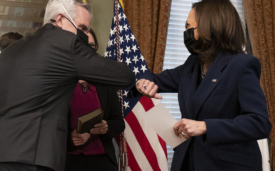 Vice President Kamala Harris and Denis McDonough bump elbows after McDunough wasceremonially sworn in by Harris as Secretary of Veterans Affairs, Tuesday, Feb. 9, 2021, at the Eisenhower Executive Office Building in Washington.