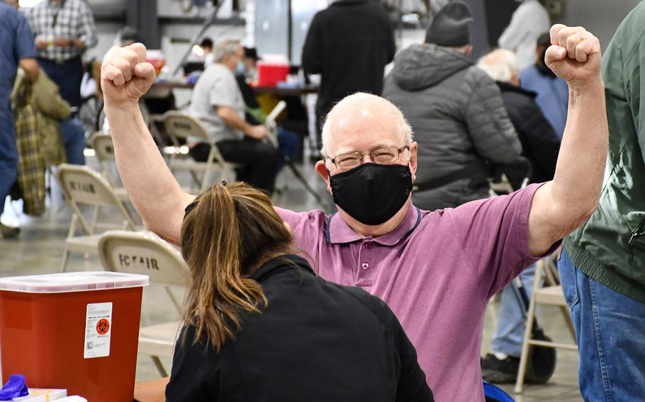Vietnam War veteran Ben Bruso, 77, throws his fists up in celebration before receiving his second dose of the Moderna coronavirus vaccine on Tuesday, March 2, 2021. The Department of Veterans Affairs vaccinated 529 veterans at the event, which was held at the Flathead County Fairgrounds in Kalispell, Montana.