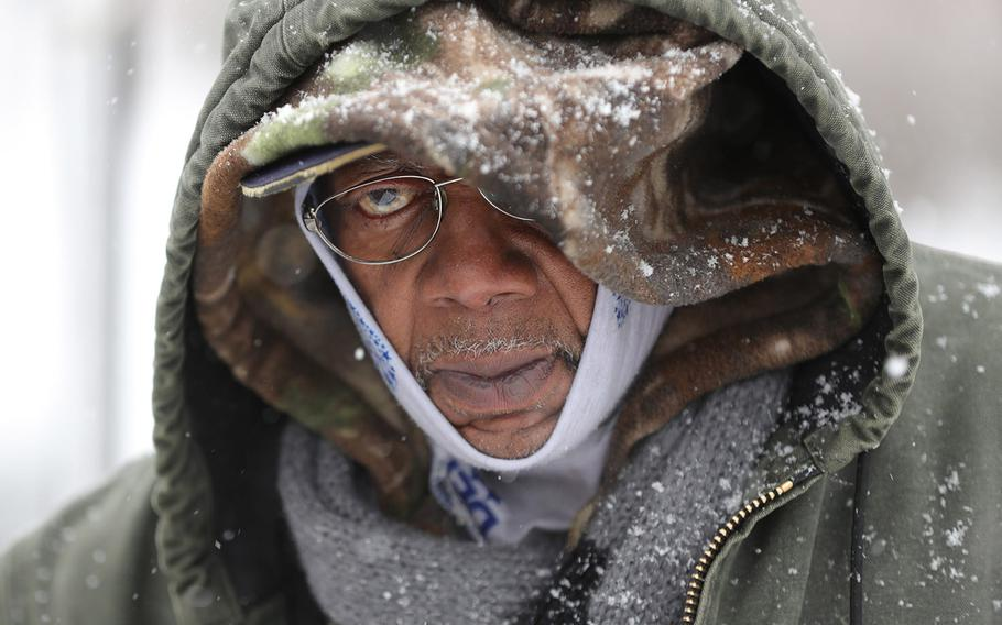 In a February 26, 2020 photo, homeless Army veteran Bobbie King makes his way to his volunteer position at the Nova Project in Detroit.