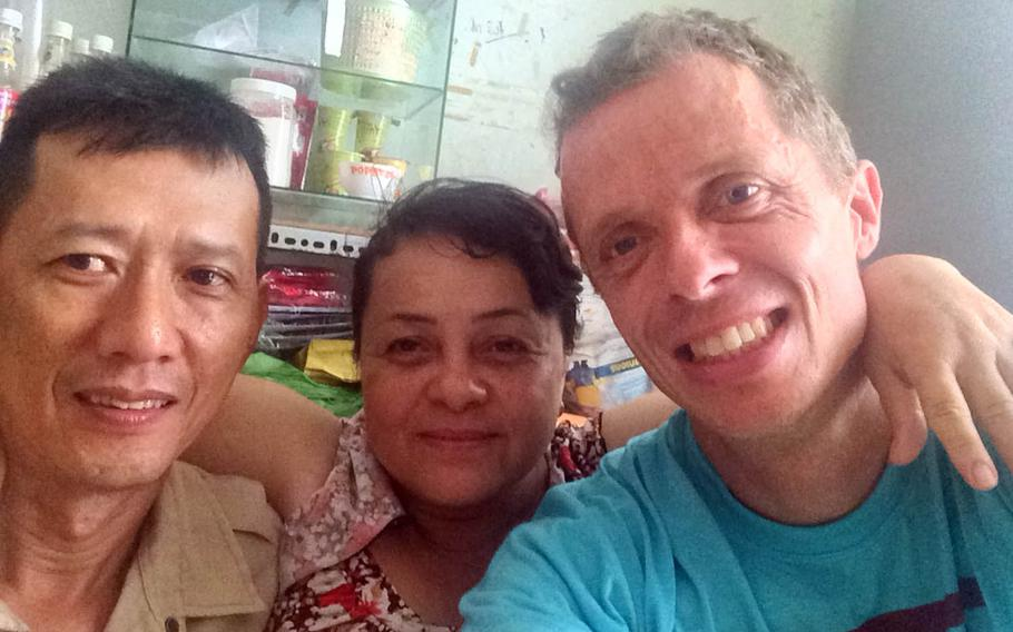 Brian Hjort poses with friends in Ho Chi Minh City, Vietnam, in 2016. The antique furniture repairman from Copenhagen, Denmark, helps Amerasians in Vietnam and the Philippines find their American GI fathers.