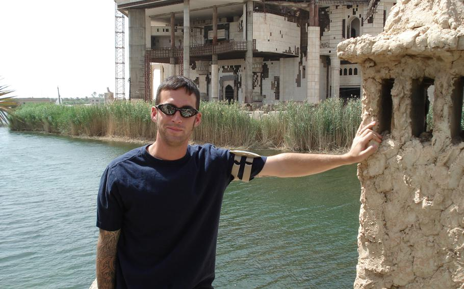 Army Staff Sgt. Mark Jackson poses in front of ''Flintstone Palace'' at Camp Slayer, Baghdad, in 2007. Jackson was exposed to toxins in Iraq, Afghanistan and Uzbekistan when he was deployed after the attacks of 9/11.