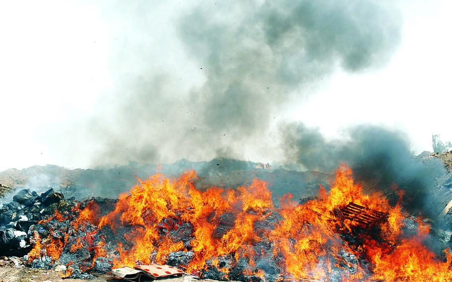 The burn pit at Balad Air Base, Iraq, was in full operation in 2008. Many of the bills under consideration in Congress aim to help veterans exposed to open-air burn pits, which were used throughout the 1990s and the post-9/11 wars to burn garbage, jet fuel, paint, medical waste, plastics and more.