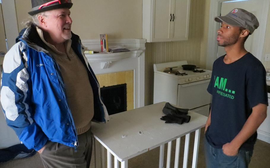 Ken Leslie, left, the founder of Veterans Matter, talked with Greg Johnson, an Iraq War veteran, last month in Johnson's apartment in Toledo, Ohio. Leslie's Toledo-based organization paid the $540 rent deposit that helped Johnson, who was homeless last summer, move into the space in September.