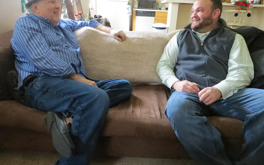 Ken Leslie, left, the founder of Veterans Matter, dropped by the apartment of Army veteran Dave Hammond last month in Toledo, Ohio. Leslie's Toledo-based nonprofit paid the $475 rent deposit that helped Hammond, who had been homeless for two years, move into the space in October.