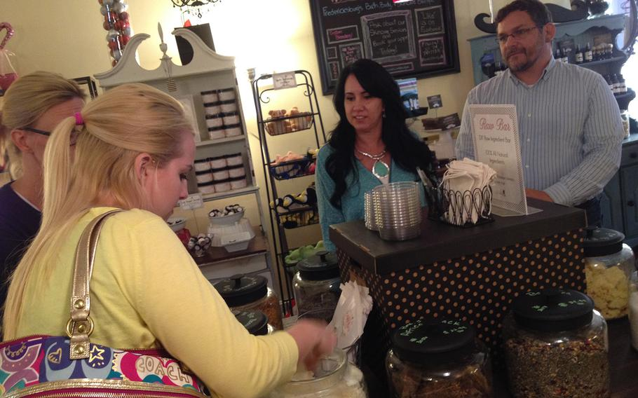 Fred an Crystal Wellman look on as customers peruse their soap at Ladyburg Apothecary, the boutique shop they co-own in Fredericksburg, Va. Wellman, a former Army scout, is one of the many veterans who have started their own businesses in the greater Washington, D.C.-metro area.