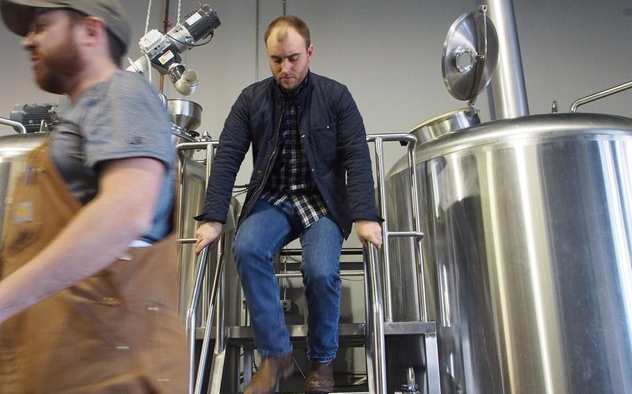 Marine veteran Sean Arroyo checks tanks at his brewery, Hertiage Brewing Co., in Manassas, VA. Arroyo, who served in Iraq, is one of the many post-9/11 veterans starting their own businesses.
