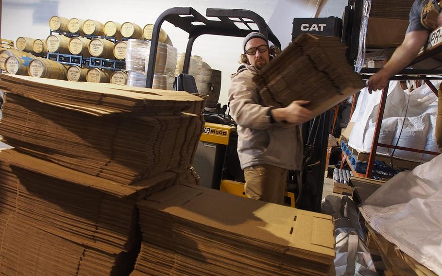 Heritage Brewing Co. head brewer Bo Elliot, an Army veteran, moves boxes at the Mannasas, VA, brewery, a veteran-owned company where more than 70 percent of employees have served in the Armed Forces.
