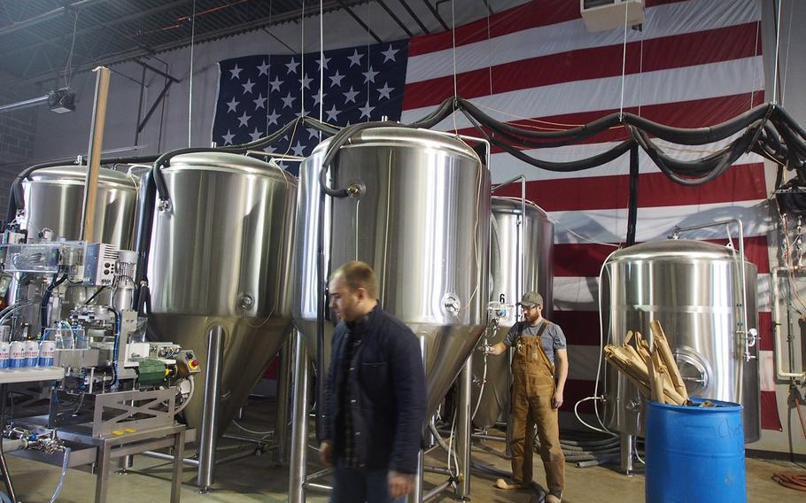 Marine veteran Sean Arroyo, foreground, and Chris Hampel, at Heritage Brewing, Co., in Manassas, VA. Amid a big push to hire veterans returning from Iraq and Afghanistan, many veterans are hiring themselves by starting businesses.