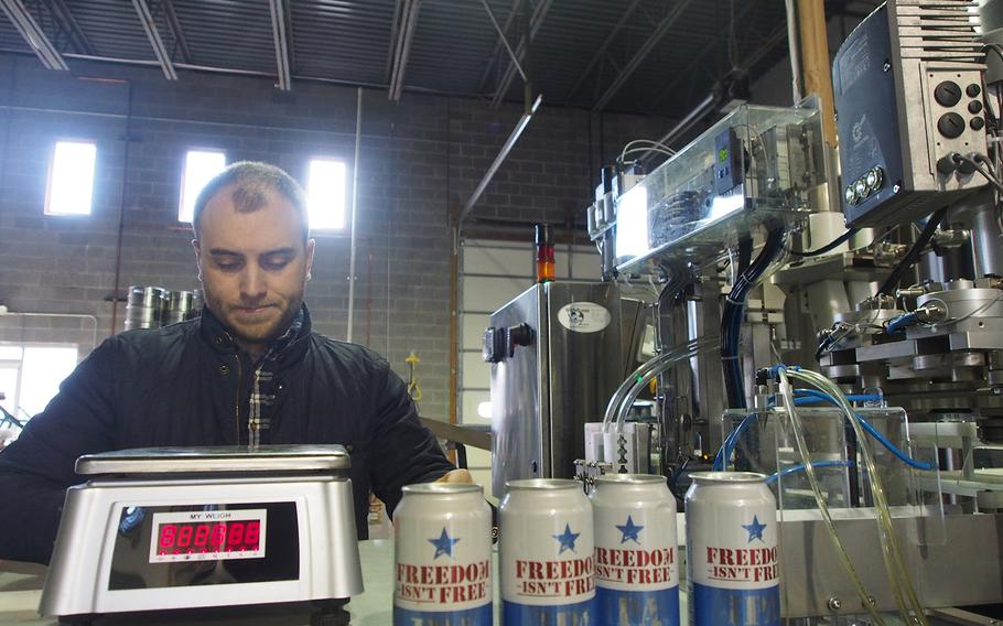 Marine veteran Sean Arroyo prepares to weigh cans of beer at Heritage Brewing Co., the brewery he opened with his brother, Ryan, who is in the Army. After a tightly controlled life in the military, many veterans opt for the freedom of entrepreneurship.