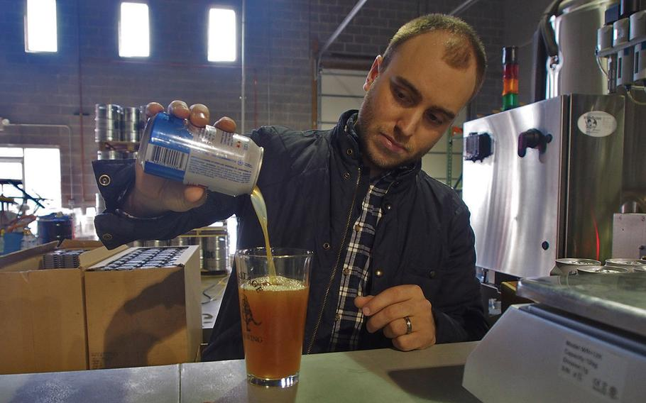 Sean Arroyo, an Iraq War veteran, pours a beer at his brewery, Heritage Brewing Co., in Manassas, Va. More than 70 percent of the staff at Heritage are veterans.