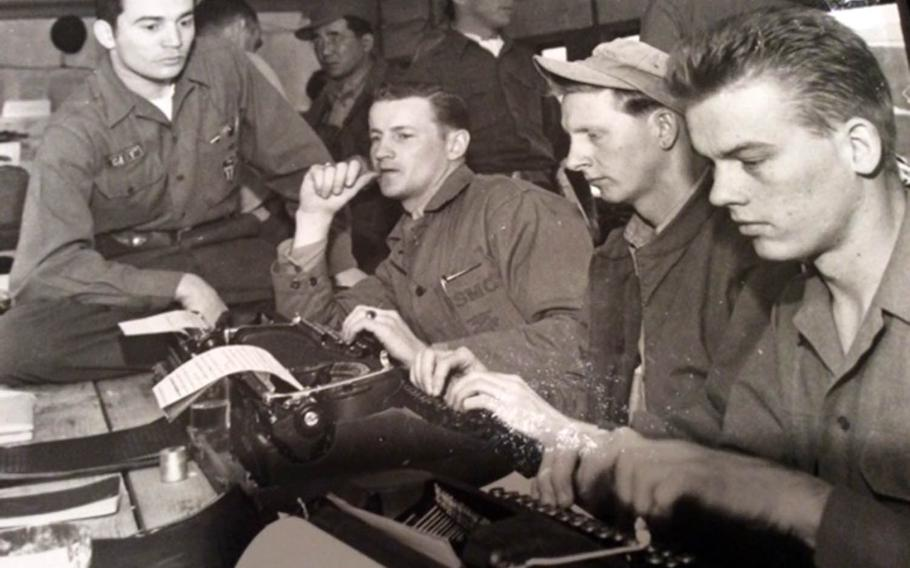 Marine Sgt. Frank Praytor, second from left, works with other Stars and Stripes combat correspondents in Munsan-ni, Korea, in April 1953.