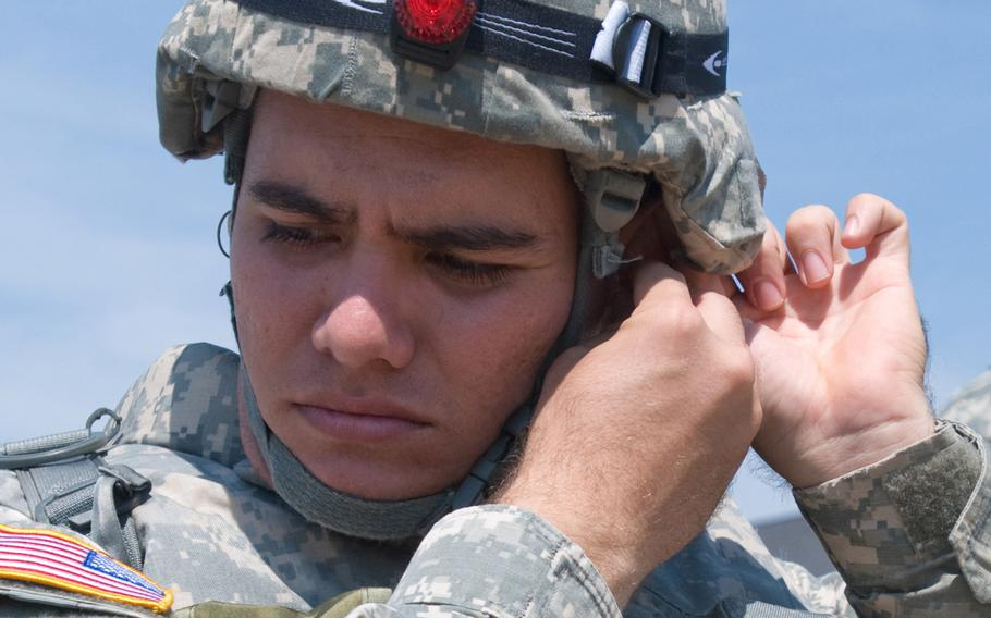 Spc. Coca Temoananui, assigned to the 311th Signal Command, puts in ear protection prior to a helicopter flight, in 2012.  A jury on Friday, May 28, 2021, determined 3M was not liable, negligent or fraudulent when selling earplugs to the military, according to court documents.