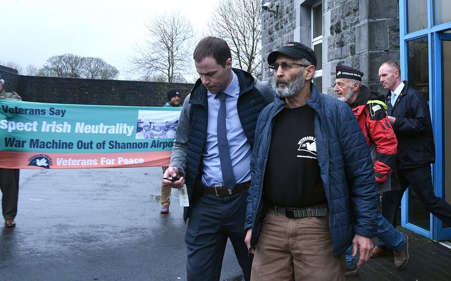 U.S. Veterans for Peace activists Ken Mayers and Tarak Kauff are shown following their March 18, 2019, arraignment in Ennis, Ireland.The veterans turned peace activists are awaiting trial on charges of trespassing in connection with allegations they approached a suspected U.S. military aircraft on layover at the Shannon Airport.