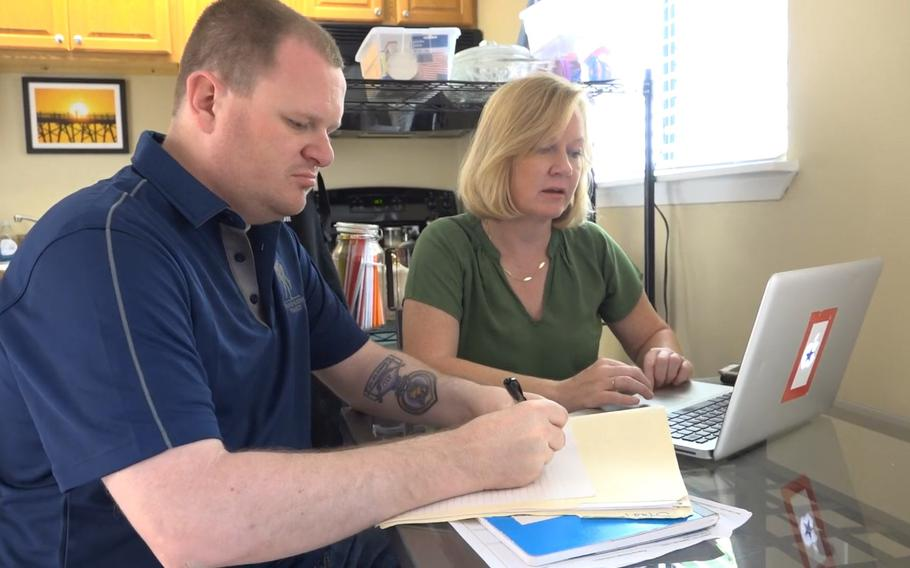 Jennifer Mackinday, right, takes care of her brother, retired Army Spc. James Smith, who was wounded by a roadside bomb in Iraq in 2005. Jennifer Mackinday is now a national advocate for family caregivers of wounded veterans.