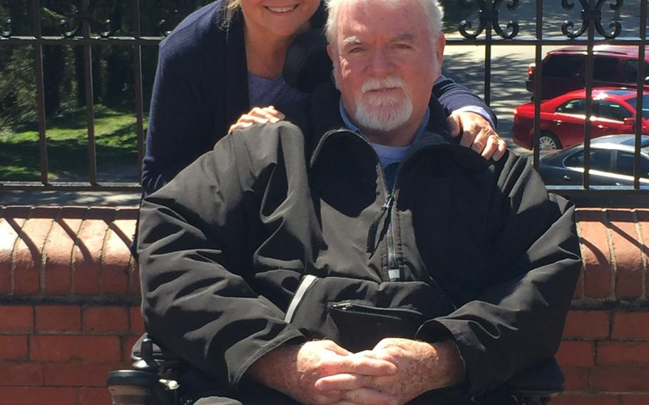 Mary Hahn Ward is shown with her husband Tom, a Vietnam-era Marine veteran who in 2010 was diagnosed with amyotrophic lateral sclerosis, also known as Lou Gehrig's disease. The coronavirus pandemic has increased the physical and mental burden on caregivers like Ward, whose husband is at high risk from the virus.