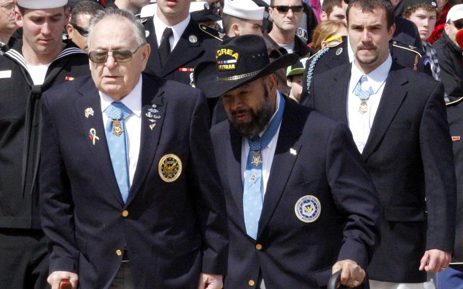 Medal of Honor recipients Ronald Rosser, left, Rodolfo Hernandez, center, and Salvatore Giunta leave a wreath-laying ceremony at Arlington National Cemetery, March 25, 2011. Stars and Stripes