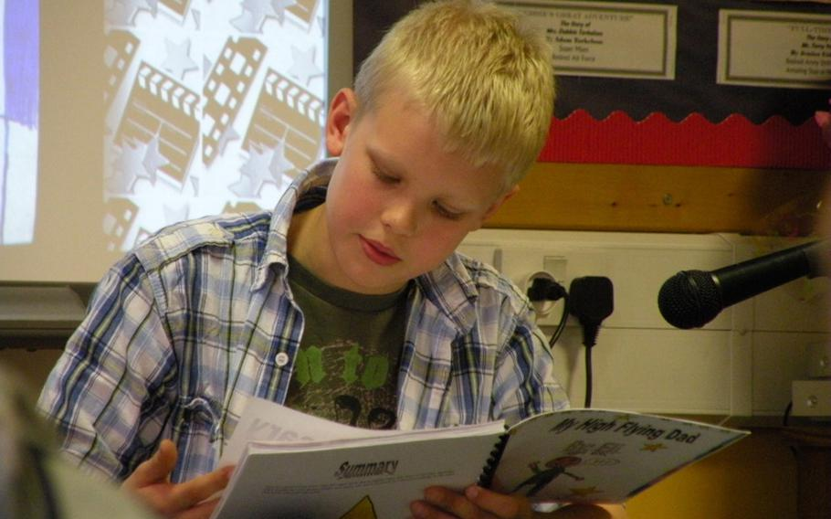 """Eli Haynie reads from his book, """"My High Flying Dad,"""" during an authors tea, April 7, to honor his local hero and father, Capt. Kevin Haynie from RAF Mildenhal's 351st Air Refueling Squadron. Haynie is a student in Karen Griffis' class at Feltwell Elementary School."""